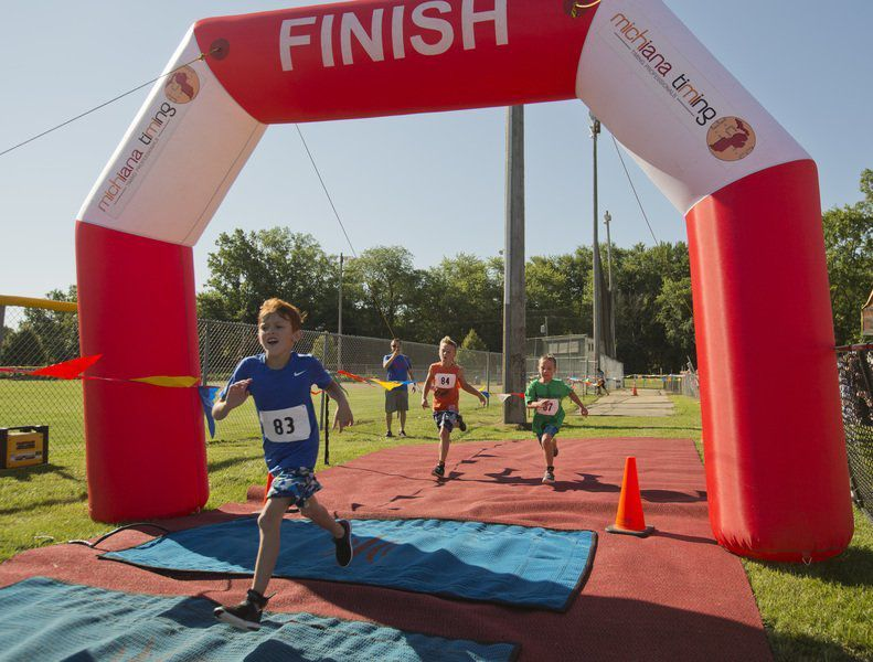 Child running through finish line.